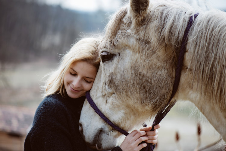 WomanWithHorse_750x500